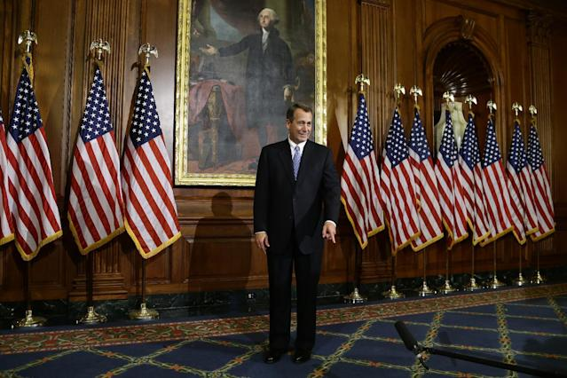 House Speaker John Boehner of Ohio points to a microphone in between performing mock swearing ins, Thursday, Jan. 3, 2013, on Capitol Hill in Washington, as the 113th Congress began. (AP Photo/Charles Dharapak)