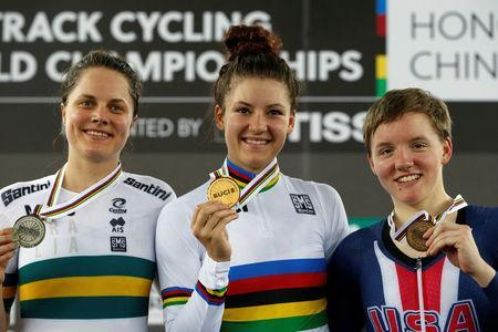 Cycling - UCI Track World Championships - Women's Individual Pursuit, Final - Hong Kong, China – 15/4/17 - Australia's Ashlee Ankudinoff, Chloe Dygert and Kelly Catlin of the U.S. celebrate with medals. REUTERS/Bobby Yip