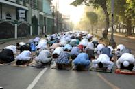 In Jakarta and elsewhere, some heeded an official request not to go inside mosques but instead gathered to pray on nearby roads