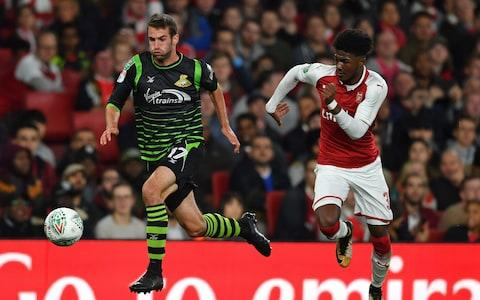 Arsene Wenger may have shifted his League Cup selection policy from fielding a youth team to giving fringe players minutes, but the competition is still the best place to see Arsenal youngsters in competitive action. On Wednesday night, the focus was on three academy graduateswho were given the chance to impress in the Carabao Cup third-round win over Doncaster Rovers. Telegraph Sport runs the rule over the trio, and assesses their chances of making a breakthrough into the first team. Reiss Nelson Most of the pre-match excitement about Arsene Wenger's team selection on Wednesday night was the chance to see the highly-rated 17-year-old Reiss Nelson, whose squad number is more than three times his age. Nelson has been with the club since the age of nine and impressed in pre-season with his swashbuckling displays in the Emirates Cup and on the tour of Australia. He also came on for the final minutes of last week's 3-1 Europa League win against Cologne, but this was a full debut. As he did against Benfica in the Emirates Cup, Nelson started in the right wing-back position, though it quickly became apparent that he had only a passing interest in defending, often bombing beyond Theo Walcott or meandering inside. Nelson's suspect positioning was perhaps unsurprising given that he plays mainly as an attacking midfielder for the under-23s, for whom he has scored six goals in five appearances this season. His confidence and ability going forward was evident all night, with his bursts up the right flank causing havoc in the Doncaster defence and a couple of efforts drawing smart saves from the visitors' goalkeeper Ian Lawlor. Defensively though, Nelson was shaky and he was twice badly caught out in the second half to gift Doncaster openings that more clinical forwards would have profited from. Reiss Nelson gets involved for Arsenal against Doncaster on Wednesday night There was a moment in the first half that summarised the youngster's night, whenhe made a mess of a clearance 