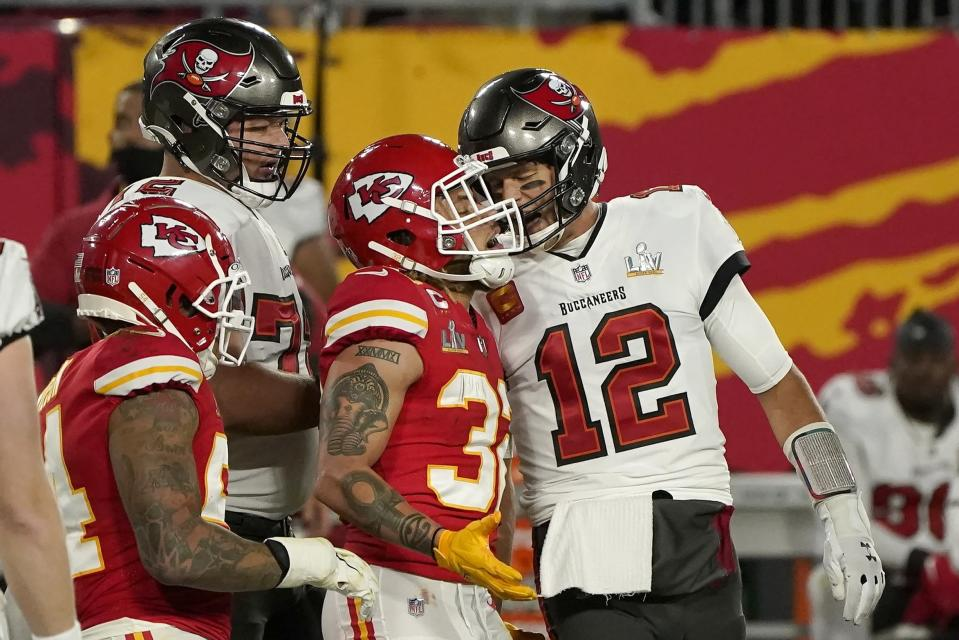 Tampa Bay Buccaneers quarterback Tom Brady (12) talks with Kansas City Chiefs strong safety Tyrann Mathieu (32) after throwing a touchdown pass during the first half of the NFL Super Bowl 55 football game Sunday, Feb. 7, 2021, in Tampa, Fla. (AP Photo/Gregory Bull)