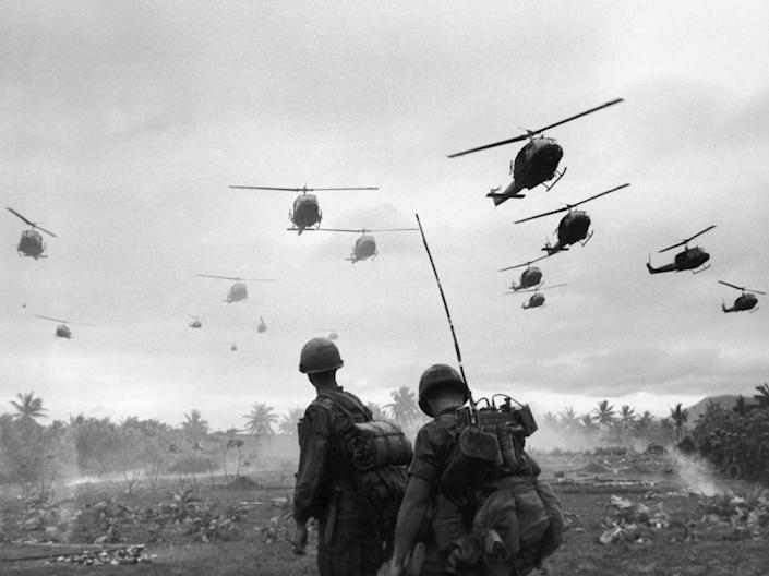 In this file photo, the second wave of combat helicopters of the 1st Air Cavalry Division fly over an isolated landing zone during Operation Pershing, a search and destroy mission on the Bong Son Plain and An Lao Valley of South Vietnam, during the Vietnam War. That war killed nearly 60,000 Americans and ultimately left the country bitterly divided throughout much of the 1970s.