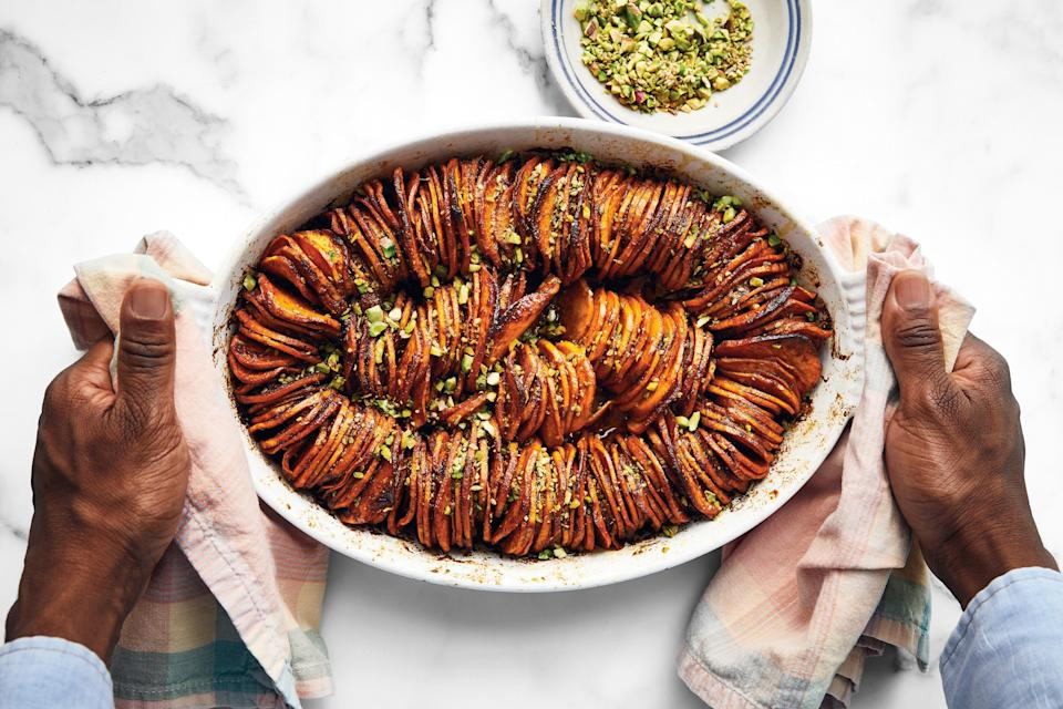 """Harissa lends both a spiciness and an earthiness to this savory sweet potato masterpiece. <a href=""""https://www.epicurious.com/recipes/food/views/shingled-sweet-potatoes-with-harissa?mbid=synd_yahoo_rss"""" rel=""""nofollow noopener"""" target=""""_blank"""" data-ylk=""""slk:See recipe."""" class=""""link rapid-noclick-resp"""">See recipe.</a>"""