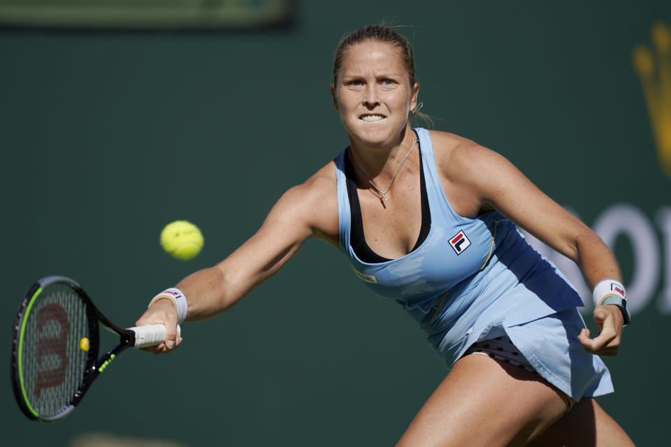Shelby Rogers returns a shot to Leylah Fernandez, of Canada, at the BNP Paribas Open tennis tournament Tuesday, Oct. 12, 2021, in Indian Wells, Calif. (AP Photo/Mark J. Terrill)