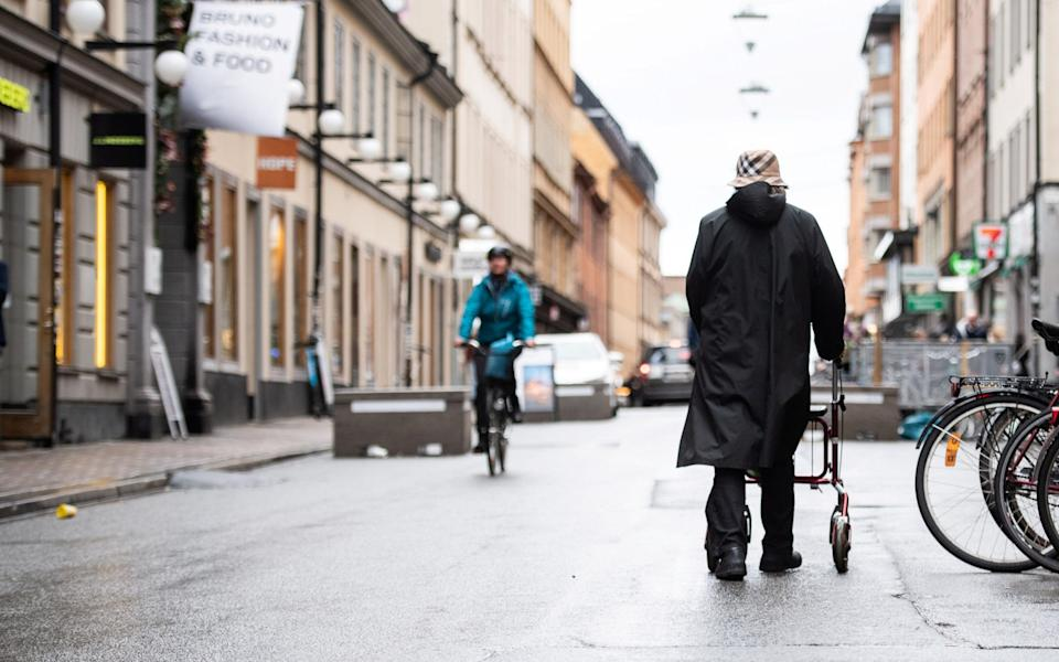 Woman strolls through the Sodermalm area of Stockholm -  TT NEWS AGENCY / REUTERS