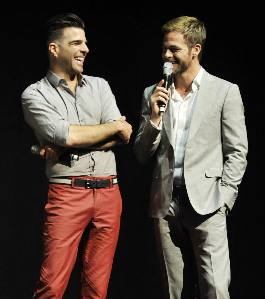 "Zachary Quinto, left, and Chris Pine, cast members in the forthcoming film ""Star Trek Into Darkness,"" share a laugh as they answer questions about the film onstage at CinemaCon 2013's Opening Night Presentation from Paramount Pictures at Caesars Palace on Tuesday, April 15, 2013 in Las Vegas. (Photo by Chris Pizzello/Invision/AP)"