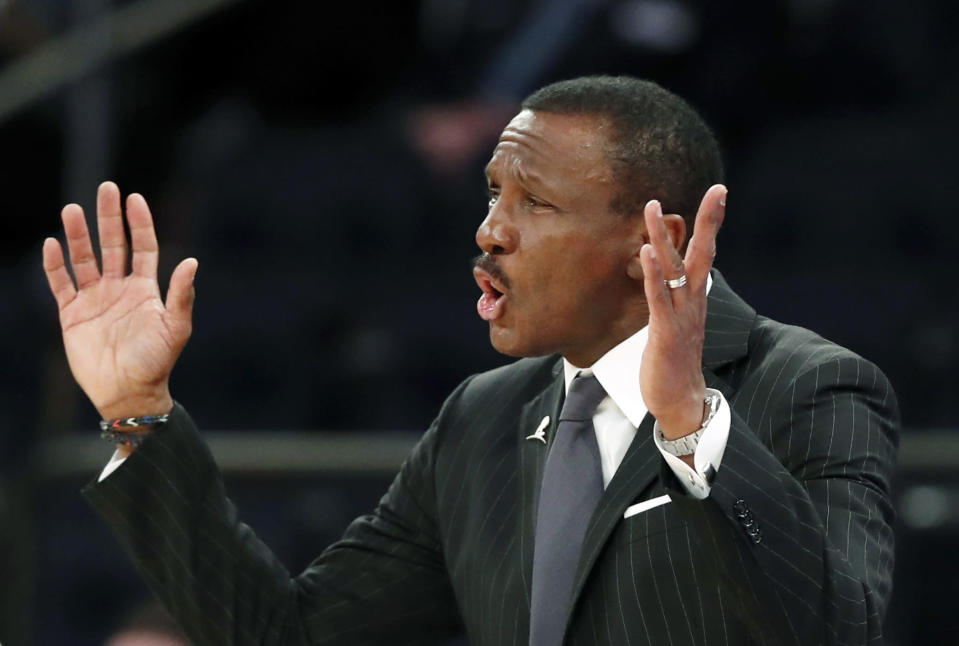 FILE - In this March 8, 2020, file photo, Detroit Pistons head coach Dwane Casey gestures during the second half of an NBA basketball game against the New York Knicks in New York. With Andre Drummond traded and Blake Griffin's health again in question, the Detroit Pistons face an uncertain future. (AP Photo/Kathy Willens, File)
