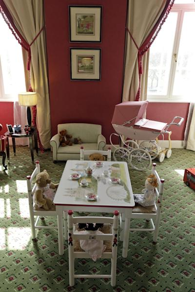 In this Tuesday, April 30, 2013 photo, a hotel nursery suite, designed by Dragons, a small British family business that was also tapped to design nurseries for British royals, is seen at a central London hotel. Britain's Prince William and Kate, formally known as the Duchess of Cambridge, plan to move into apartments at London's Kensington Palace soon after the baby is born in July. Few will ever get a glimpse inside the room where the future British monarch will grow up, but the designers hired by late Princess Diana to create her sons' William and Harry's nursery at the palace can offer some expert hints. (AP Photo/Lefteris Pitarakis)