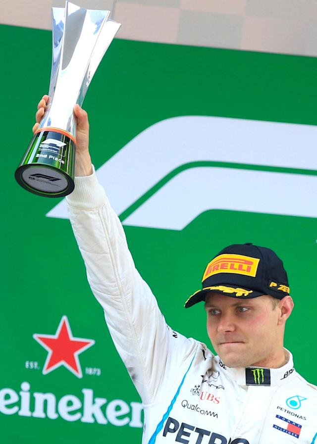 Formula One F1 - Chinese Grand Prix - Shanghai International Circuit, Shanghai, China - April 15, 2018 Mercedes' Valtteri Bottas celebrates with a trophy after finishing second in the race REUTERS/Aly Song