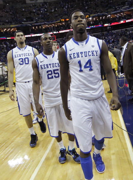 Kentucky forward Michael Kidd-Gilchrist (14) walks off the court with teammates Marquis Teague (25) and  Eloy Vargas (30) following a 71-64 loss to Vanderbilt during the second half of an NCAA college basketball game in the championship game of the 2012 Southeastern Conference tournament at the New Orleans Arena in New Orleans, Sunday, March 11, 2012. Vanderbilt beat Kentucky 71-64. (AP Photo/Gerald Herbert)