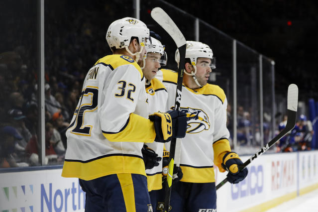 Nashville Predators' Calle Jarnkrok, center, celebrates with teammates Dante Fabbro, right, and Yakov Trenin after scoring a goal during the third period of an NHL hockey game against the New York Islanders Tuesday, Dec. 17, 2019, in Uniondale, N.Y. The Predators won 8-3. (AP Photo/Frank Franklin II)