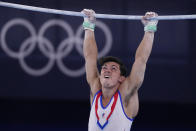 Artur Dalaloyan, of the Russian Olympic Committee, performs on the horizontal bar during the artistic men's team final at the 2020 Summer Olympics, Monday, July 26, 2021, in Tokyo. (AP Photo/Ashley Landis)