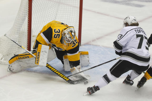 Pittsburgh Penguins goaltender Tristan Jarry (35) makes a save against Los Angeles Kings' Tyler Toffoli (73) during the first period of an NHL hockey game, Saturday, Dec. 14, 2019, in Pittsburgh. (AP Photo/Keith Srakocic)
