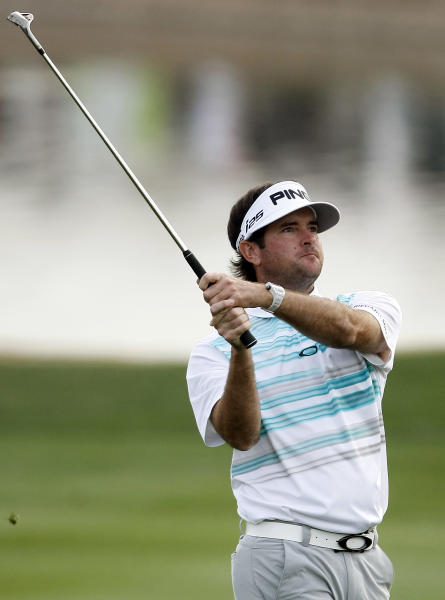 Bubba Watson hits his approach shot on the 18th hole during the first round of the Phoenix Open golf tournament on Thursday, Jan. 30, 2014, in Scottsdale, Ariz. (AP Photo/Rick Scuteri)