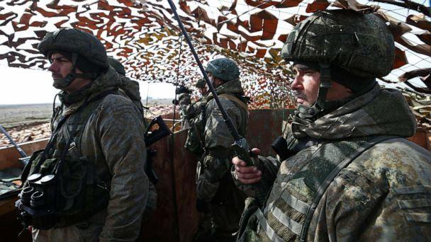 PHOTO: Members of the Russian military are seen at a command point during an exercise held by units of the Novorossiysk guards mountain air assault division of the Russian Airborne Troops at Opuk range in Crimea, March 19, 2021. (Sergei Malgavko/TASS via Getty Images)