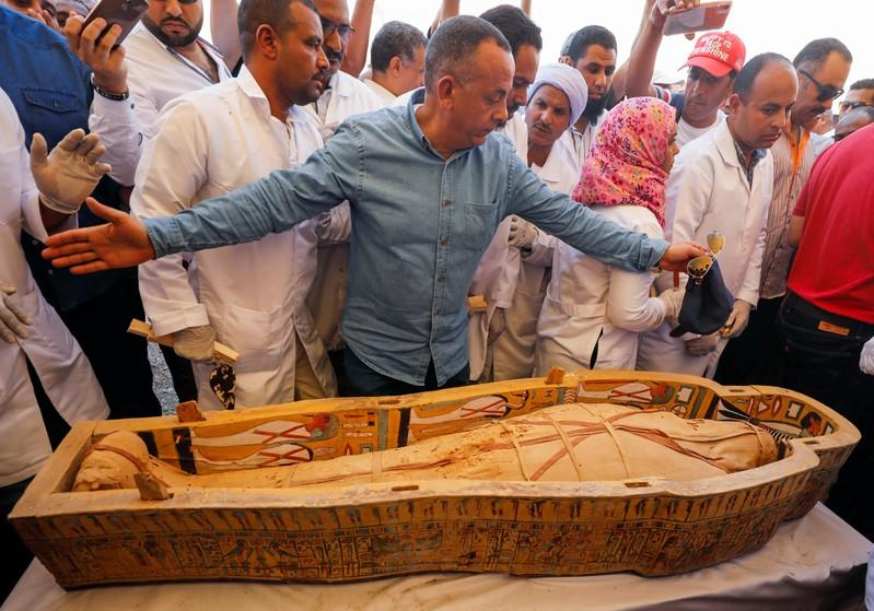 A mummy is seen inside a painted coffin discovered at Al-Asasif Necropolis in the Vally of Kings in Luxor
