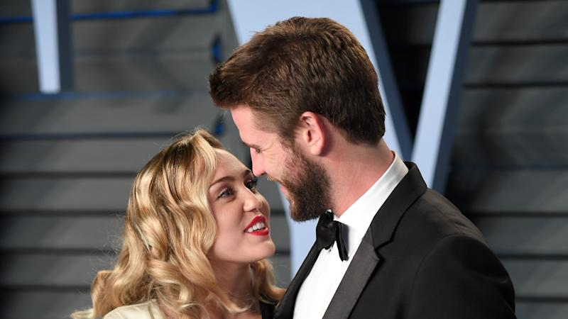 Miley Cyrus steps in for ill Liam Hemsworth at Isn't It Romantic premiere