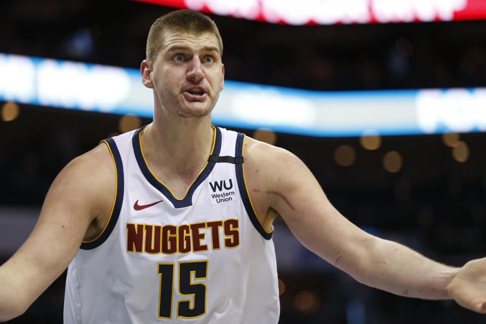 Denver Nuggets center Nikola Jokic argues a call during the second half of an NBA basketball game against the Charlotte Hornets in Charlotte, N.C., Thursday, March 5, 2020. Denver won 114-112. (AP Photo/Nell Redmond)