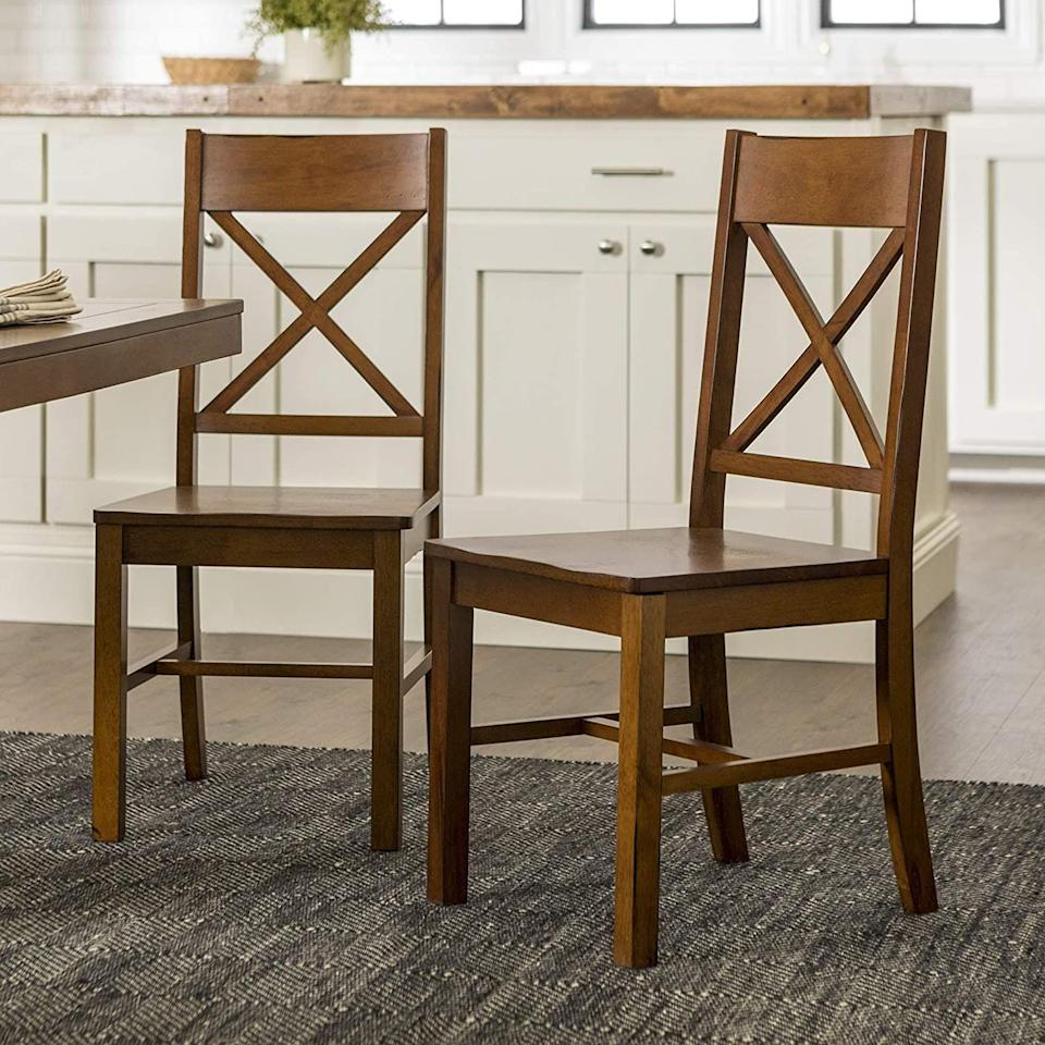 """<p><strong>Walker Edison Furniture Company</strong></p><p>amazon.com</p><p><strong>$113.99</strong></p><p><a href=""""https://www.amazon.com/dp/B007CGUPEQ?tag=syn-yahoo-20&ascsubtag=%5Bartid%7C10057.g.34196286%5Bsrc%7Cyahoo-us"""" rel=""""nofollow noopener"""" target=""""_blank"""" data-ylk=""""slk:BUY NOW"""" class=""""link rapid-noclick-resp"""">BUY NOW</a></p><p>At 58 percent off, these farmhouse style dining chairs make for a totally budget-friendly dining room upgrade. </p>"""