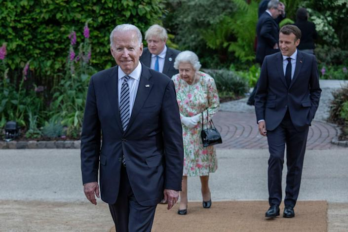 French President Emmanuel Macron, Queen Elizabeth II, British Prime Minister Boris Johnson and United States President Joe Biden arrive at a drinks reception for Queen Elizabeth II and G7 leaders at The Eden Project during the G7 Summit on June 11.