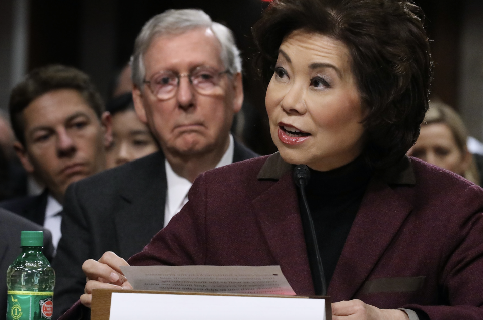 Elaine Chao testifies during her confirmation hearing to be the next U.S. secretary of transportation as her husband, Senate Majority Leader Mitch McConnell (R-KY) (2nd L) looks on, January 11, 2017 in Washington, DC. (Photo by Chip Somodevilla/Getty Images)