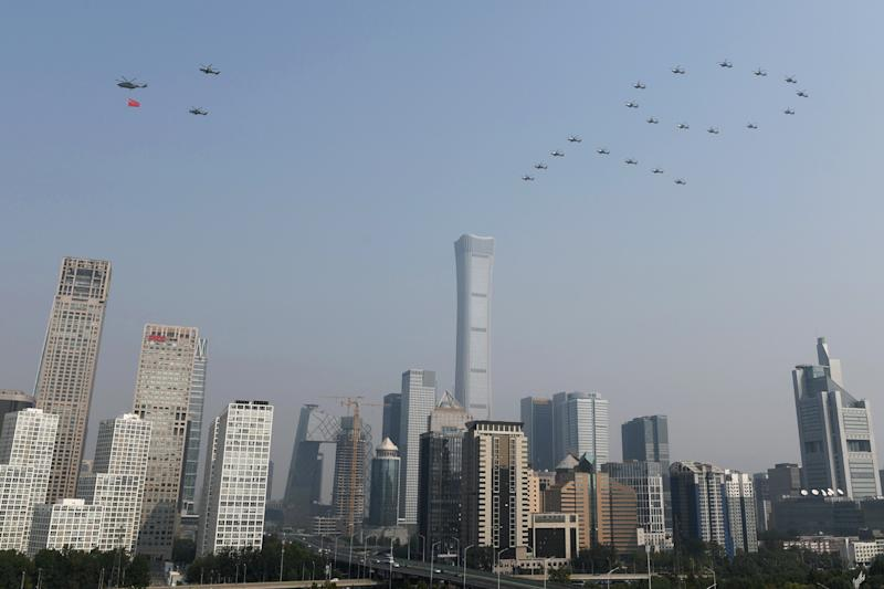 "Military helicopters fly over the Central Business District in the formation of the number ""70"" during the military parade marking the 70th founding anniversary of People's Republic of China, on its National Day in Beijing, China October 1, 2019. (Photo: Stringer/Reuters)"