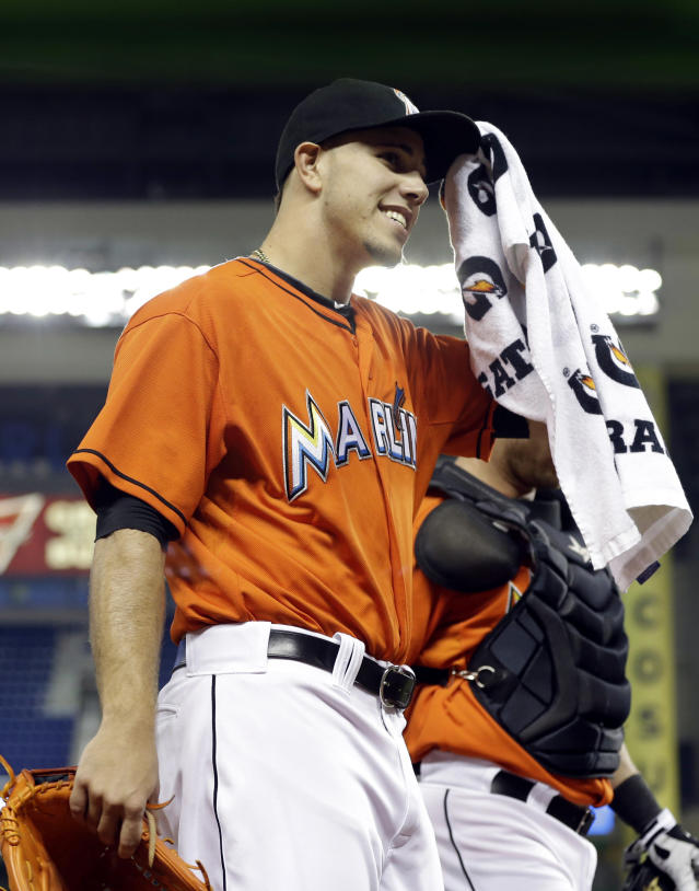 Miami Marlins starting pitcher Jose Fernandez acknowledges the cheers of the crowd as he walks onto the field before a baseball game against the Atlanta Braves, Wednesday, Sept. 11, 2013, in Miami. Fernandez will pitch his last game of the season Wednesday night. (AP Photo/Lynne Sladky)