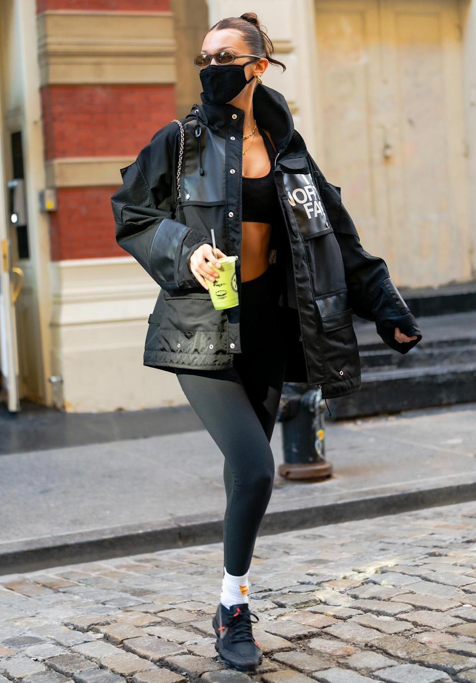 <p>Bella Hadid keeps it moving in New York City on Thursday after grabbing a green juice.</p>