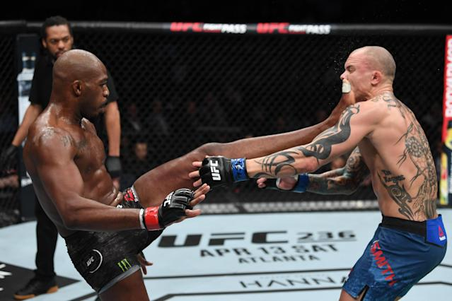 """Jon Jones kicks <a class=""""link rapid-noclick-resp"""" href=""""/ncaaf/players/276461/"""" data-ylk=""""slk:Anthony Smith"""">Anthony Smith</a> in their UFC light heavyweight championship bout during UFC 235 at T-Mobile Arena on March 2, 2019 in Las Vegas. (Zuffa LLC)"""
