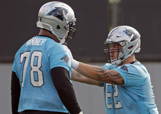 Carolina Panthers' Taylor Hearn (62) runs a drill against Zach Banner (78) during practice at the NFL football team's facility in Charlotte, N.C., Tuesday, May 22, 2018. While NFL owners are voting to approve the new Panthers owner in Atlanta, the team David Tepper is about to officially own takes to the field for the OTAs back in Charlotte with plenty of new faces. (AP Photo/Chuck Burton)
