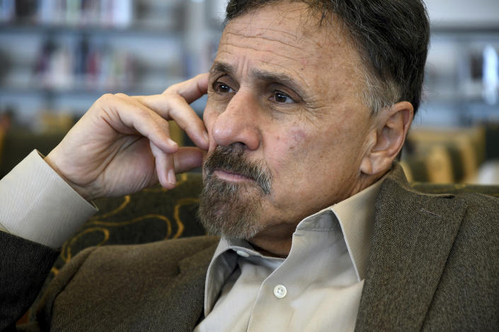 In this Saturday, March 23, 2019 photo, former Columbine principal Frank DeAngelis reflects about the upcoming 20th anniversary of the mass shooting at the suburban Denver high school. Twelve students and a teacher were killed in the April 20, 1999, attack. Several survivors and family members of the victims gathered at the school's library to speak to the media Saturday. (AP Photo/Thomas Peipert)