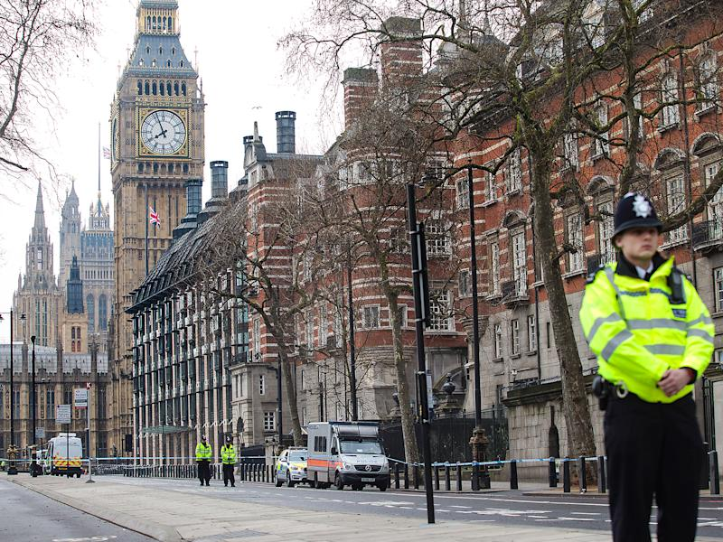 Police officers stand guard on Victoria Embankment following yesterday's attack in London, England: ge