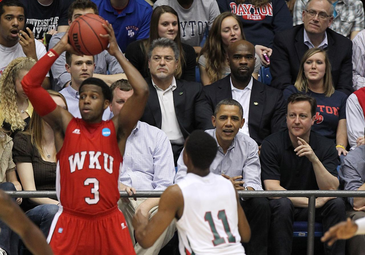 DAYTON, OH - MARCH 13:  U.S. President Barack Obama (C) and British Prime Minister David Cameron (R) watch the action at UD Arena in the first half as the Western Kentucky Hilltoppers take on the Mississippi Valley State Delta Devils in the first round of the 2011 NCAA men's basketball tournament on March 13, 2012 in Dayton, Ohio.  (Photo by Gregory Shamus/Getty Images)