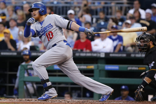 Los Angeles Dodgers' Justin Turner (10) drives in two runs with a double off Pittsburgh Pirates starting pitcher Edinson Volquez during the fourth inning of a baseball game in Pittsburgh Monday, July 21, 2014. (AP Photo/Gene J. Puskar)