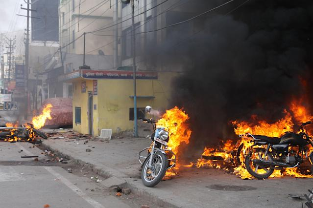 Police motorcycles burn after being set on fire during demonstrations against India's new citizenship law in Lucknow on December 19, 2019. - Indians defied bans on assembly on December 19 in cities nationwide as anger swells against a citizenship law seen as discriminatory against Muslims, following days of protests, clashes and riots that have left six dead. (Photo by STR / AFP) (Photo by STR/AFP via Getty Images)