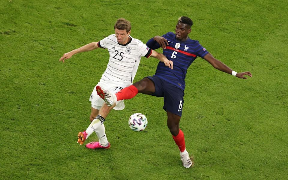 Thomas Muller and Paul Pogba battle for the ball - GETTY IMAGES