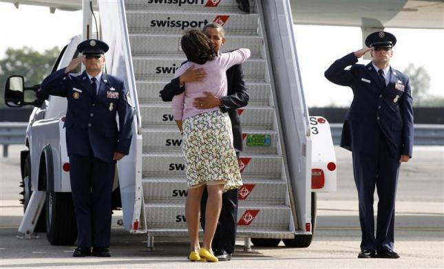Barack Obama hugs first lady Michelle at the steps of Air Force One upon his arrival in New York June 14, 2012.