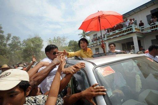 Myanmar opposition leader Aung San Suu Kyi greets supporters in Kawhmu. The April 1 by-elections saw Suu Kyi, the Nobel Peace Prize-winning democracy activist who had spent most of the past two decades under house arrest, win a seat in the military-dominated parliament