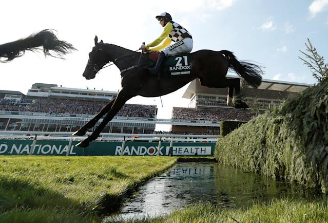 Horse Racing - Grand National Festival - Aintree Racecourse, Liverpool, Britain - April 14, 2018 Pleasant Company ridden by David Mullins in action during the 17:15 Randox Health Grand National Handicap Chase Action Images via Reuters/Matthew Childs
