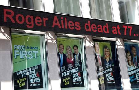 A sign displays the news that former Fox News Chairman and CEO Roger Ailes has died, on the outside of the Fox News Headquarters in New York City