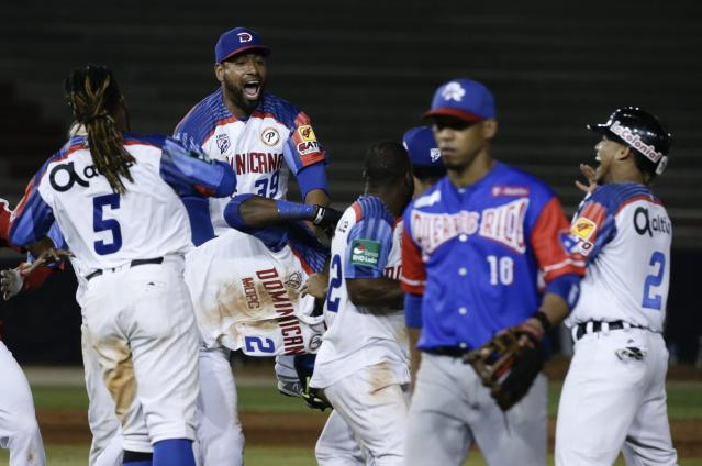 Players of the Dominican Republic's Estrellas Orientales celebrate after defeating Puerto Rico's Cangrejeros de Santurce on their Caribbean Series baseball tournament game at Rod Carew stadium in Panama City, Thursday, Feb. 7, 2019. (AP Photo/Arnulfo Franco)