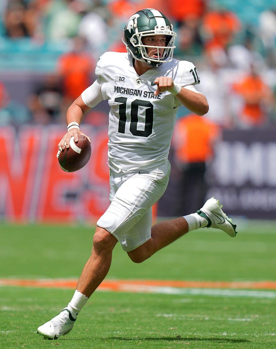 Michigan State Spartans quarterback Payton Thorne runs with the ball during the first half against the Miami Hurricanes at Hard Rock Stadium, Saturday, Sept. 18, 2021, in Miami Gardens, Fla.