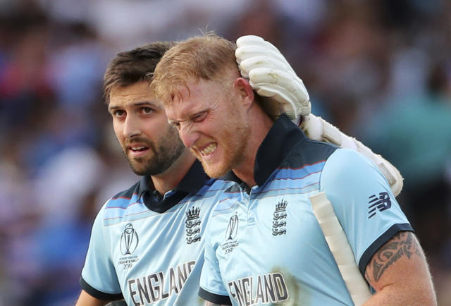 England's Ben Stokes, right, and Mark Wood leave the field at the end of their innings. (AP Photo/Aijaz Rahi)