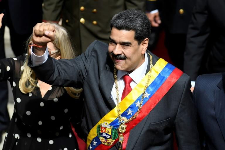 Maduro raises a clenched fist as he arrives to make his annual address to Venezuela's Constituent Assembly in Caracas