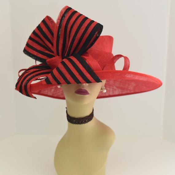 """<p><strong>MillineryByAnna</strong></p><p>etsy.com</p><p><strong>$155.00</strong></p><p><a href=""""https://go.redirectingat.com?id=74968X1596630&url=https%3A%2F%2Fwww.etsy.com%2Flisting%2F511277087%2Fm612-redblack-kentucky-derby-church&sref=https%3A%2F%2Fwww.townandcountrymag.com%2Fstyle%2Ffashion-trends%2Fg9267914%2Fbest-kentucky-derby-hats-and-fascinator-headbands%2F"""" rel=""""nofollow noopener"""" target=""""_blank"""" data-ylk=""""slk:Shop Now"""" class=""""link rapid-noclick-resp"""">Shop Now</a></p><p>A bold bow is always a Derby """"do.""""</p>"""