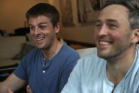 Brothers, Bryan, left, and Bradford Manning, laugh as they tell the origin story of their clothing company, Two Blind Brothers, in their New York City loft on Friday, Oct. 23, 2020. The brothers who've lost much of their vision to a rare degenerative eye disorder began their company in 2016 and have donated all of their profits, more than $700,000, to preclinical research trials to help cure blindness. (AP Photo/Jessie Wardarski)