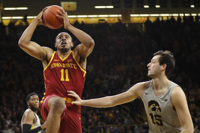 Iowa State guard Talen Horton-Tucker (11) drives to the basket over Iowa forward Ryan Kriener (15) during the first half of an NCAA college basketball game, Thursday, Dec. 6, 2018, in Iowa City, Iowa.(AP Photo/Charlie Neibergall)