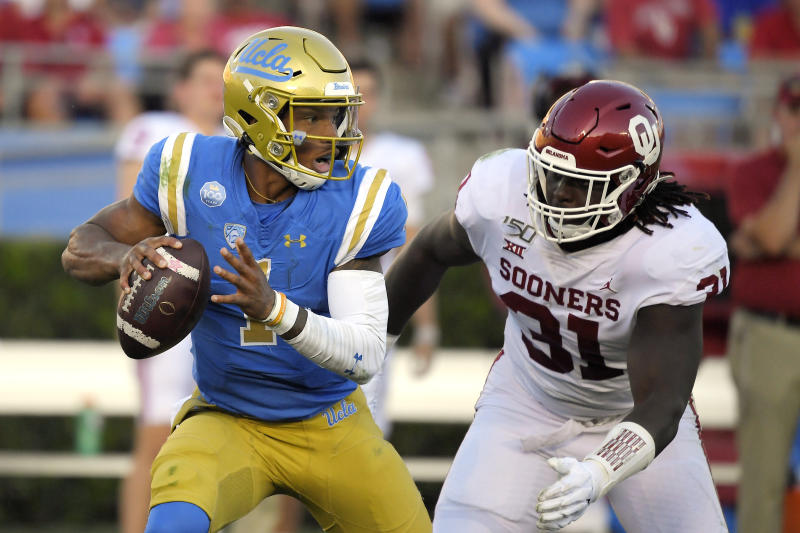 UCLA quarterback Dorian Thompson-Robinson, gets set to pass before being sacked by Oklahoma linebacker Jalen Redmond during the first half of an NCAA college football game Saturday, Sept. 14, 2019, in Pasadena, Calif. (AP Photo/Mark J. Terrill)