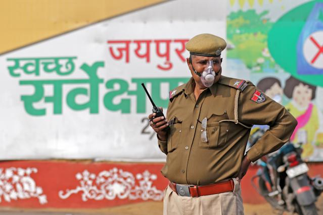 Police personnel wear protective masks in wake of the deadly novel coronavirus at a railway station in Jaipur.
