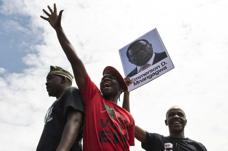 University of Zimbabwe students with a portrait of ousted vice president Emmerson Mnangagwa at a demonstration in Harare on Monday